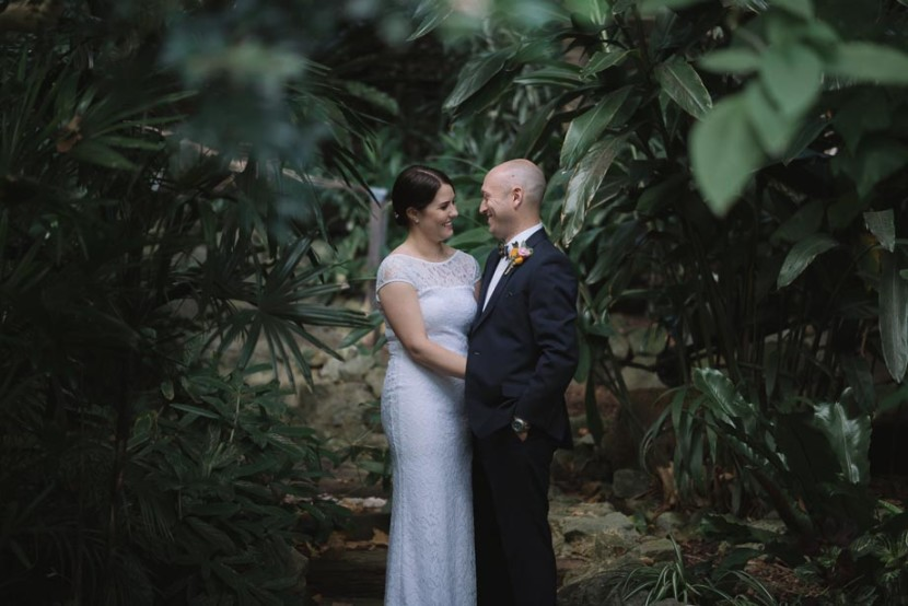 wedding-couple-standing-in-trees