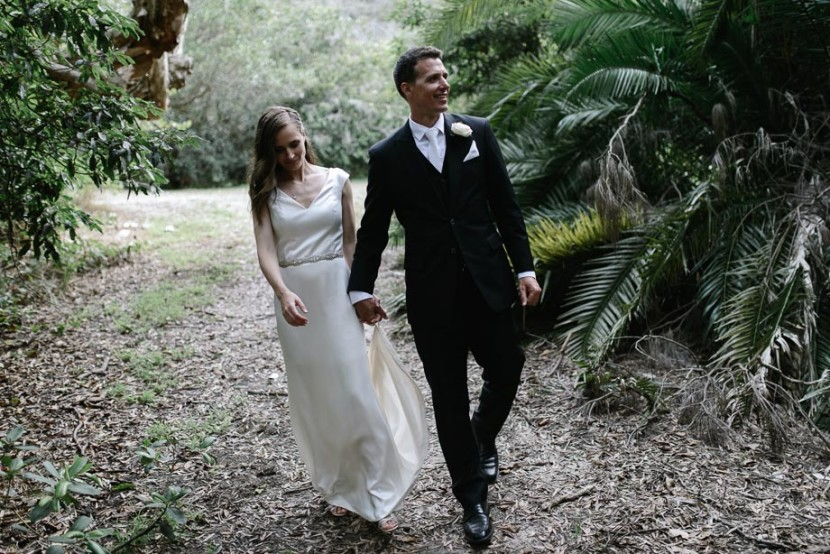 wedding-couple-walking-through-bush
