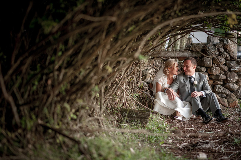 wedding-couple-sat-under-bushes