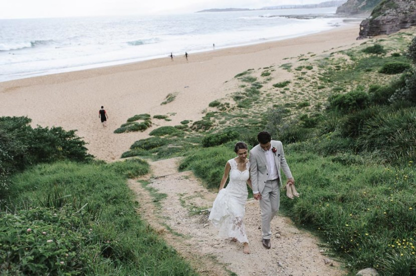 wedding-couple-walking-up-beach-stairs