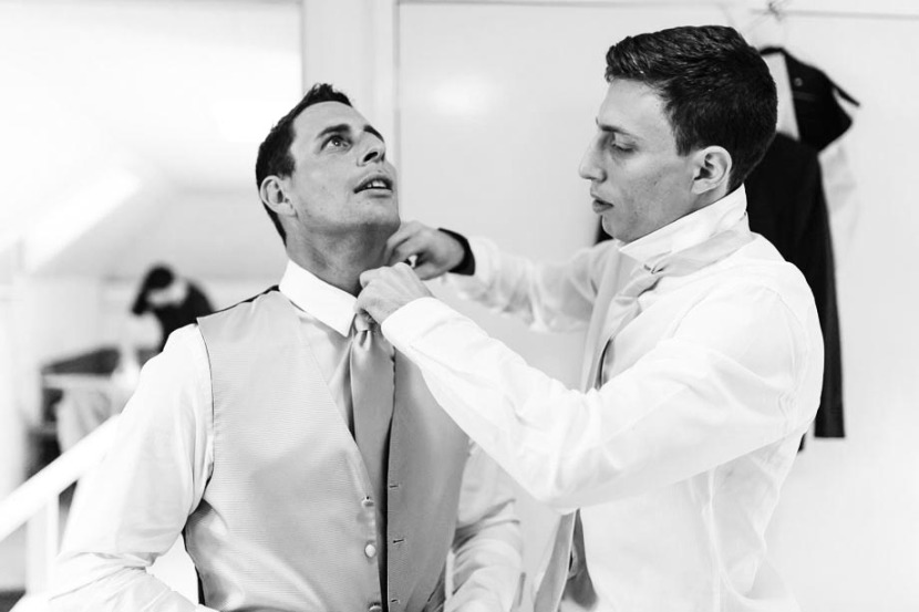 groom-getting-dressed-with-bestman