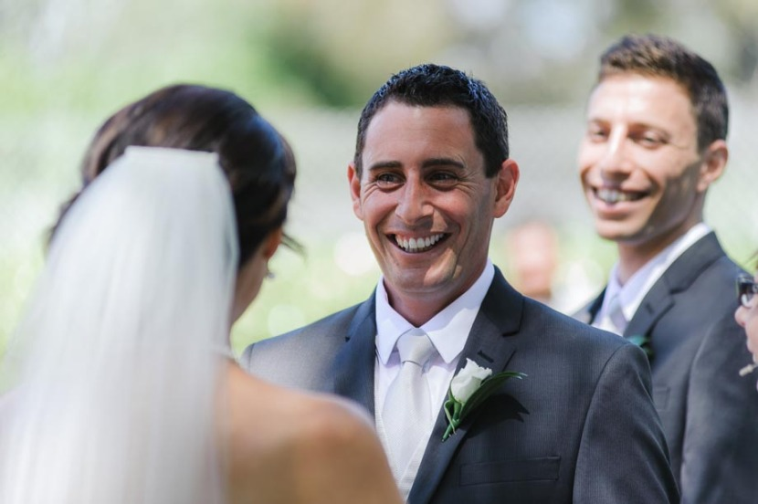 groom-laughing-during-wedding-ceremony