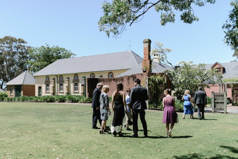 wedding-guests-walking-across-coolangatta-estate