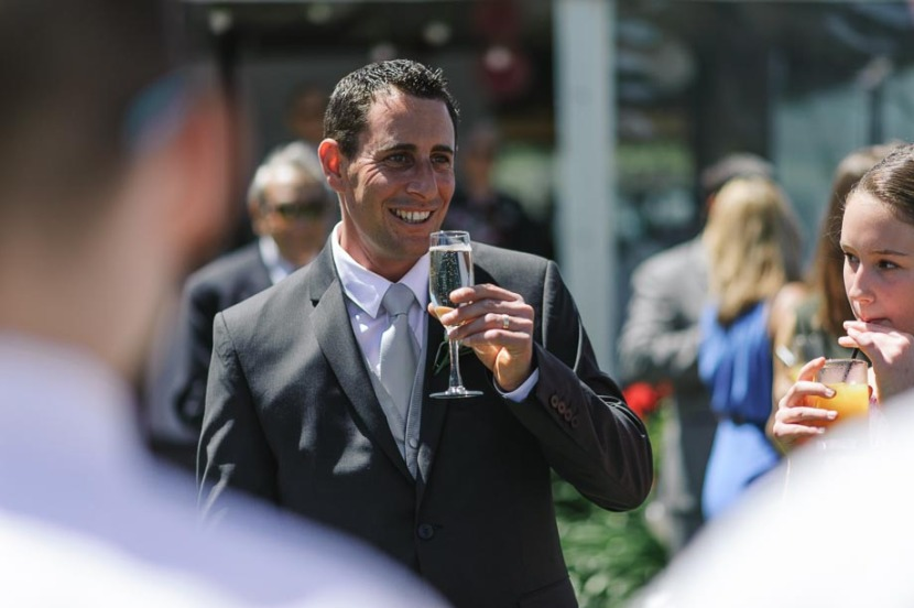 groom-drinking-champagne-wedding-reception