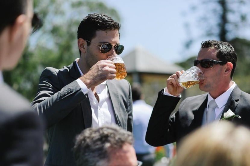 groom-and guest-drinking-beer