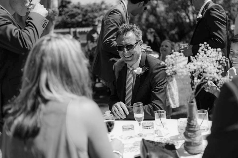 grooms-father-laughing-wedding-reception