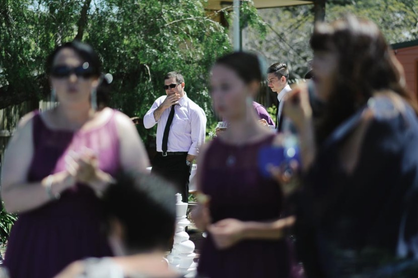 man-through-crowd-wedding-guests