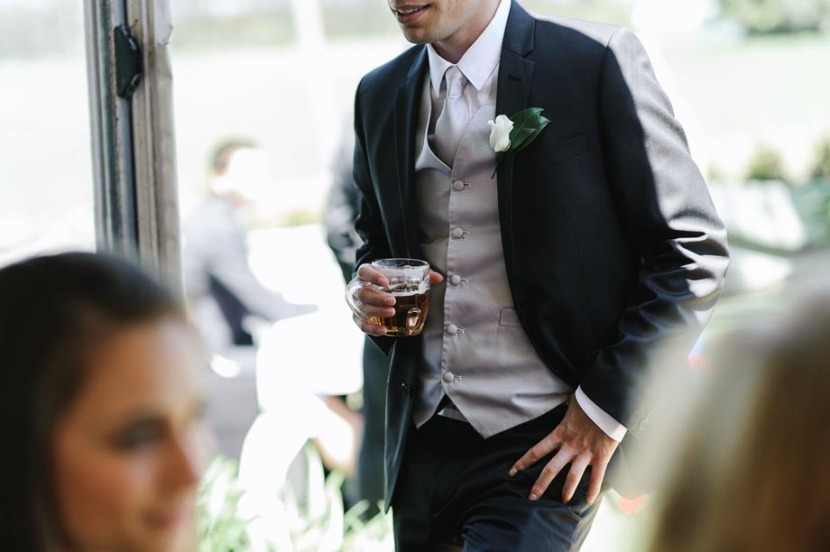 bestman-holding-glass-of-beer