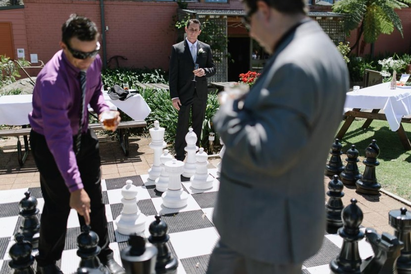 groom-playing-game-giant-chess