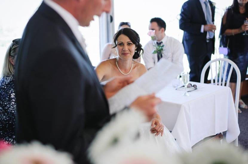 bride-listening-to-grooms-wedding-speech