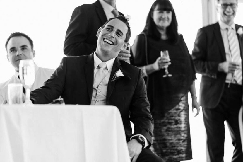 groom-laughing-during-wedding-speech