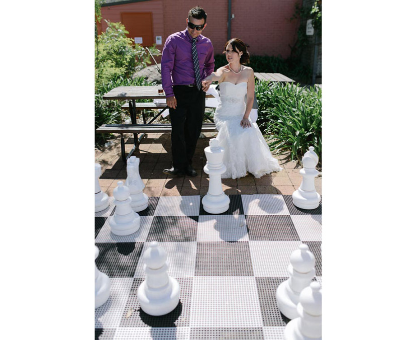 bride-playing-giant-game-chess