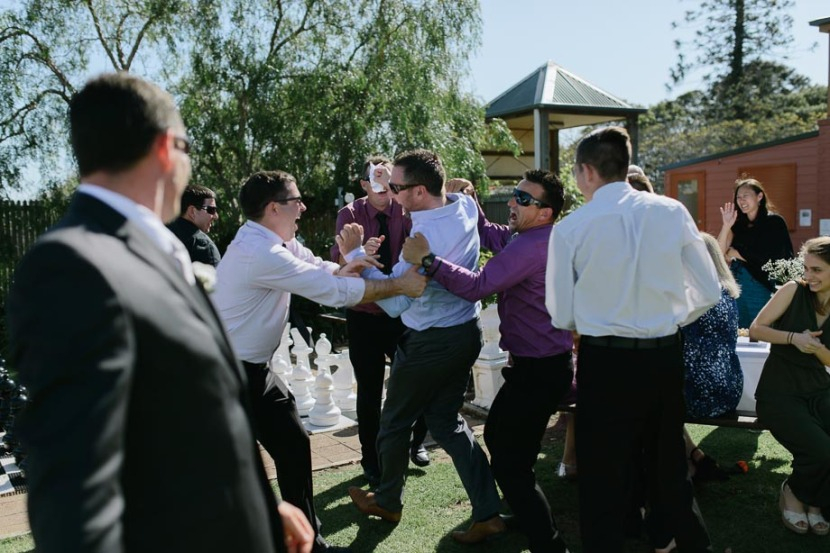 man-fighting-over-brides-garter