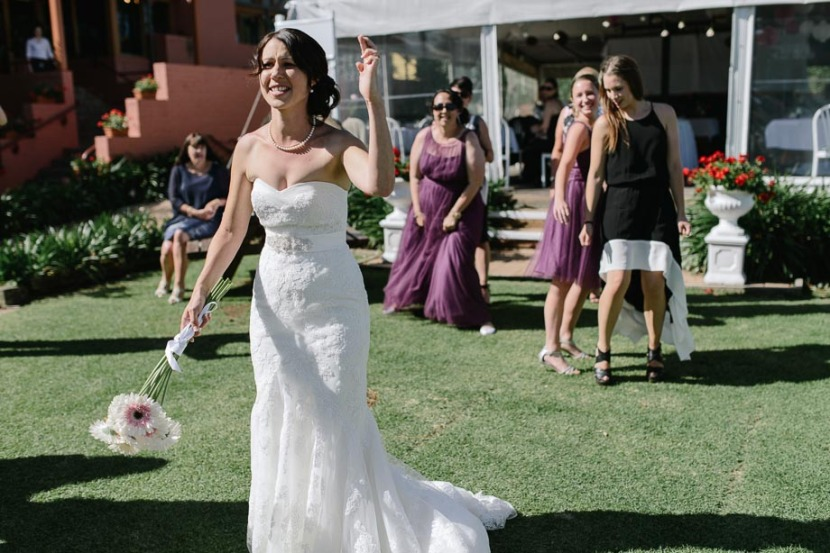 bride-about-to toss-her-bouquet