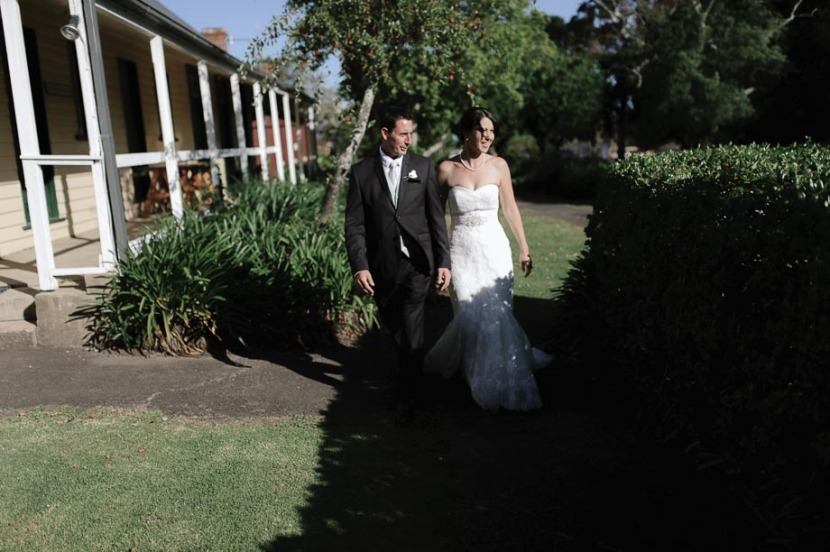 bride-groom-walking-at-coolangatta-estate