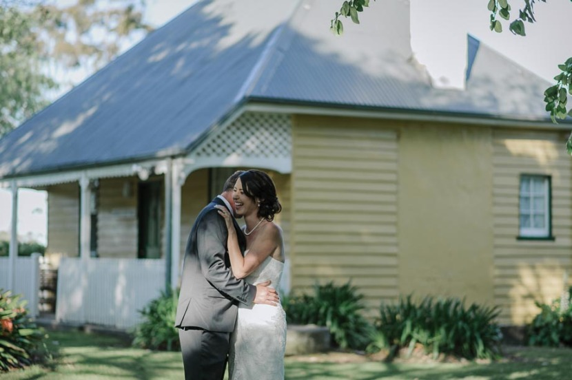 bride-groom-embracing-coolangatta-estate