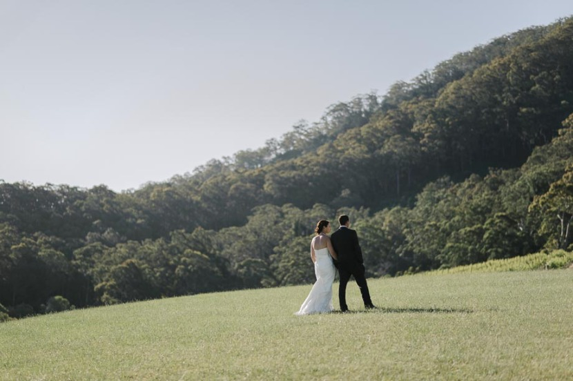 bride-groom-walking-in-coolangatta-field