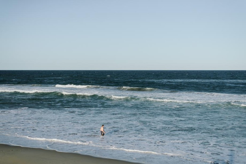 man-entering-surf-shoalhaven