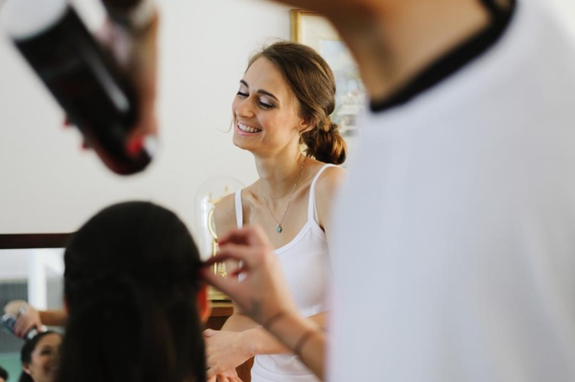 bride-laughing-during-makeup