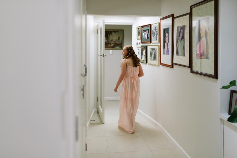 bridesmaid-in-wedding-dress-in-hallway