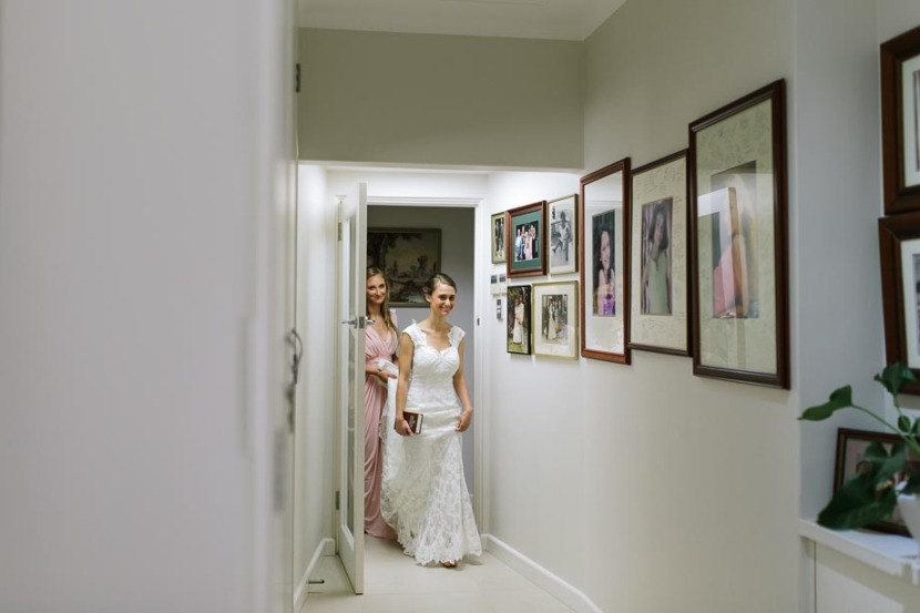 bride-in-hallway-in-wedding-dress