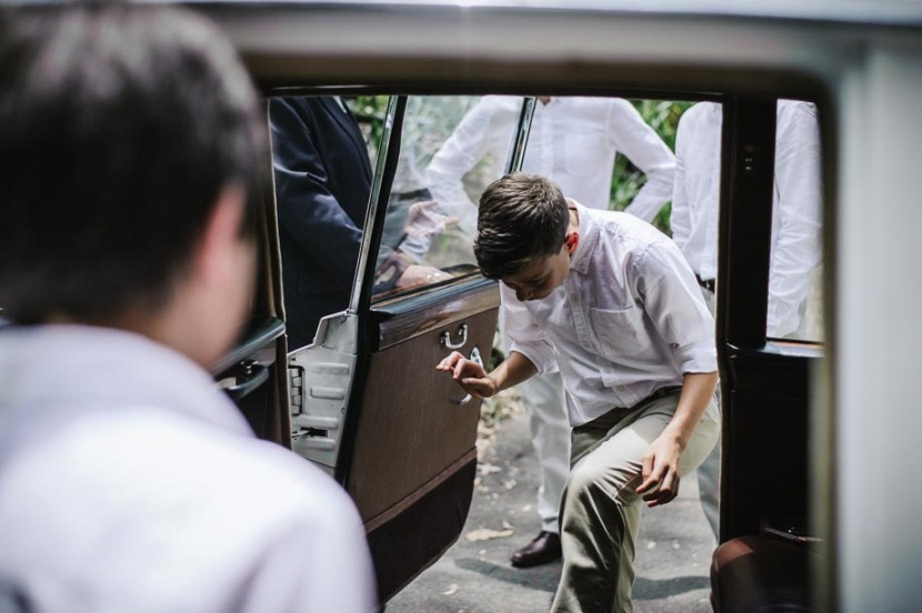 young-boy-getting-into-wedding-car