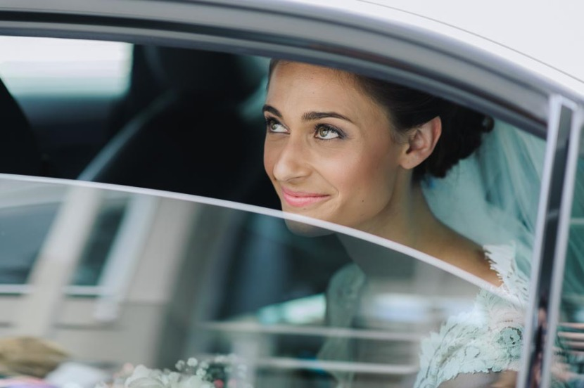 bride-looking-out-wedding-car-window