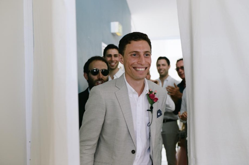groom-walking-in-doorway