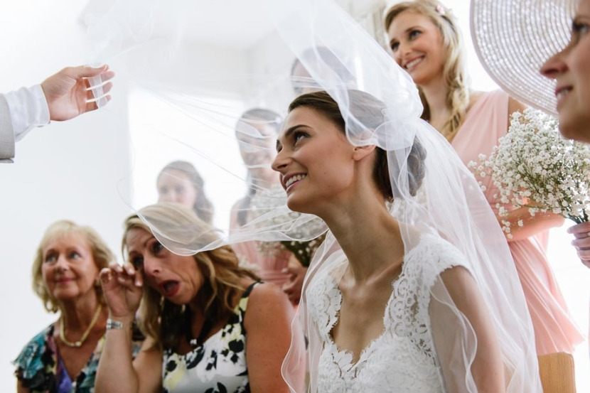 brides-veil-being-lifted-during-bedeken