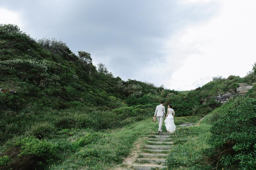 bride-groom-walking-up-steps-tumeretta-beach
