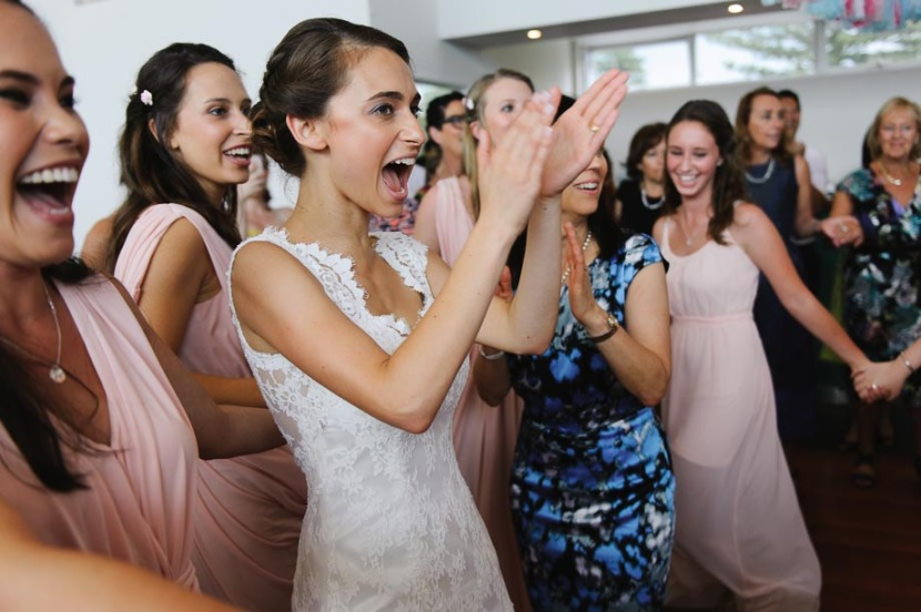 laughing-bride-during-jewish-wedding-hora