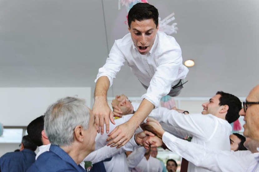groom-being-tossed-in-the-air-jewish-hora