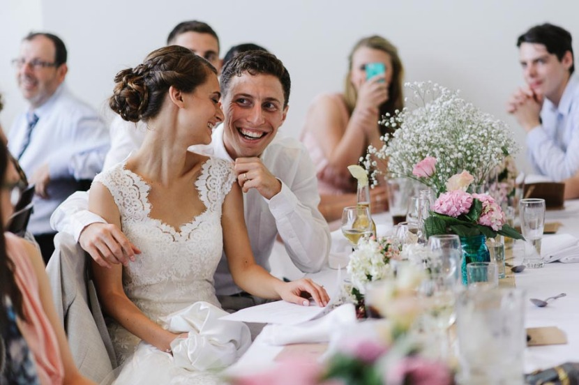 bride-groom-laughing-during-wedding-speeches