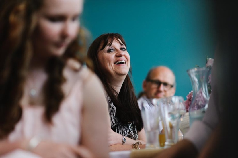 wedding-guests-laughing-during-wedding-speeches