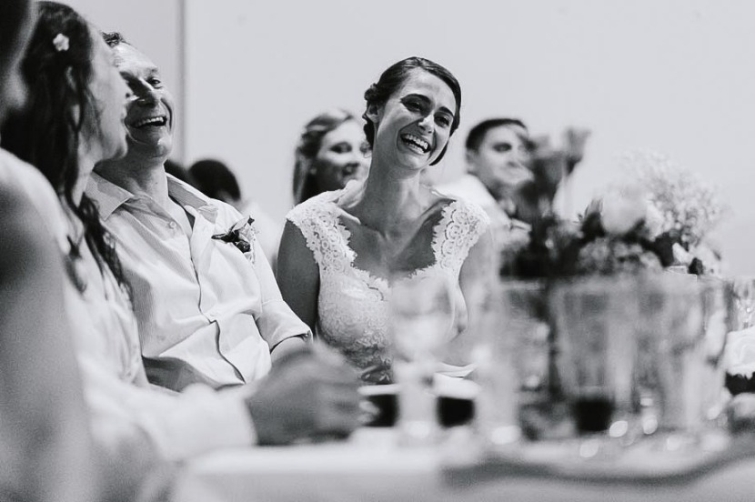 bride-laughing-sat-at-wedding-table
