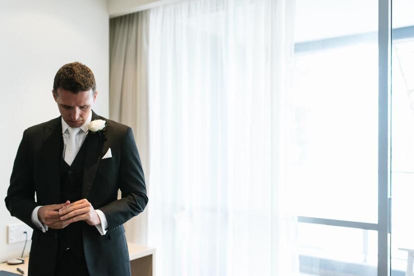 groom-looking-down-at-floor