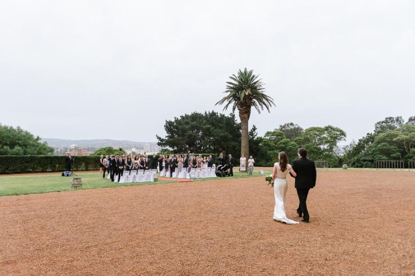 bride-and-father-walking-on-icms-lawn