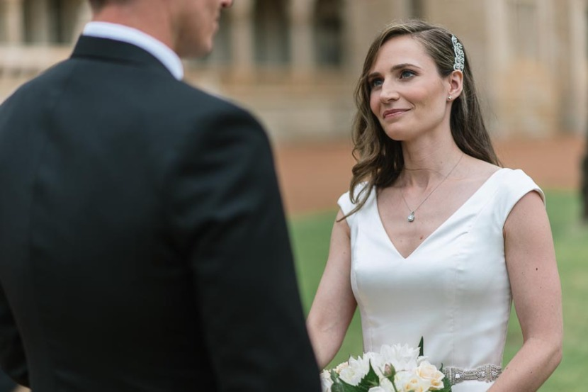 bride-smiling-at-groom-wedding