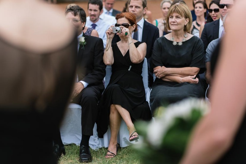 woman-taking-wedding-ceremony-photo