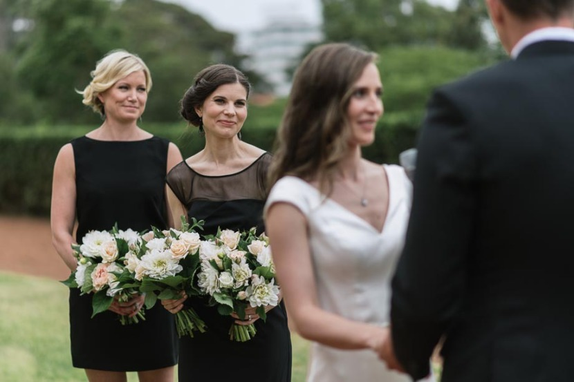 bridesmaid-laughing-during-manly-wedding-ceremony