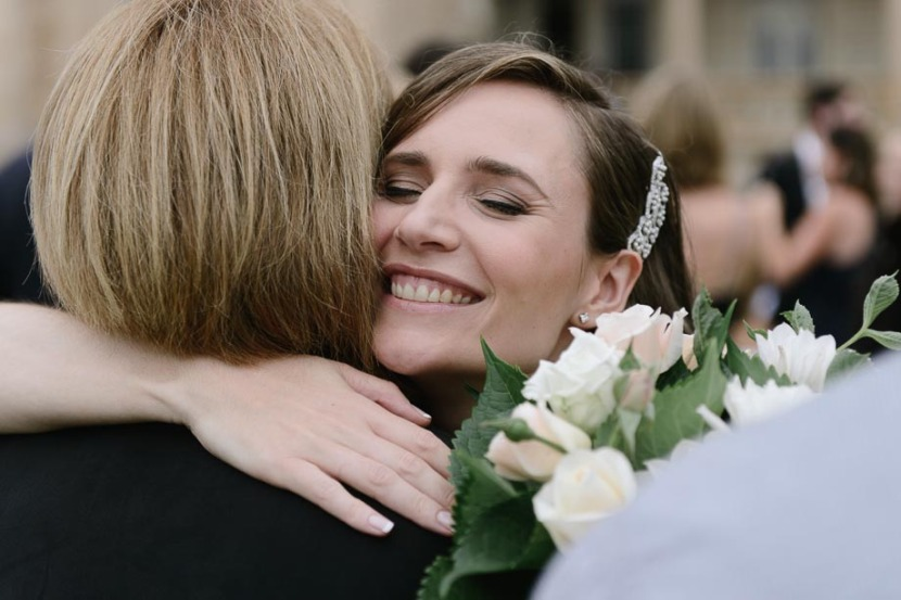 bride-hugging-wedding-guest
