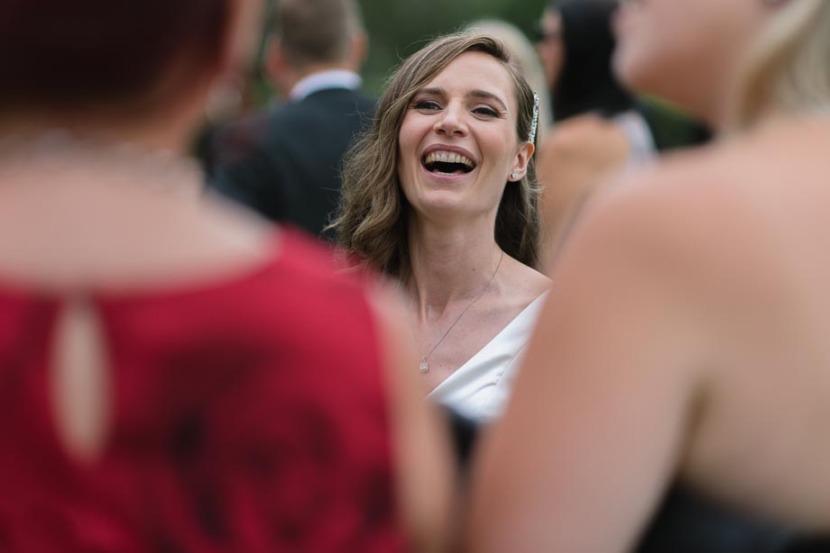 bride-laughing-at-wedding