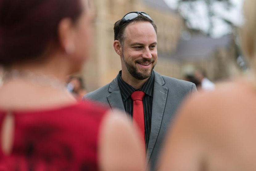 wedding-guest-smiling-with-glasses-on-head