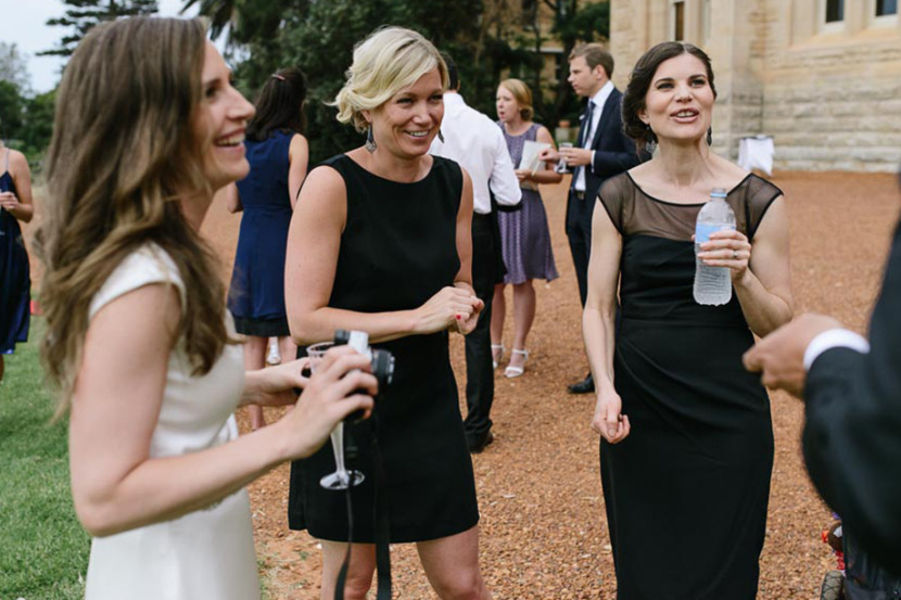bride-laughing-with-bridesmaids