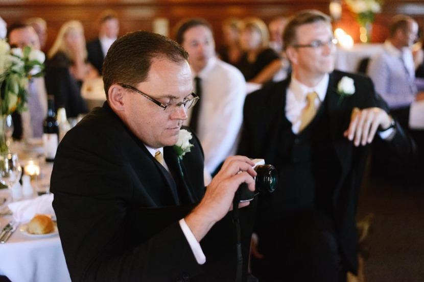 man-videoing-wedding-speeches