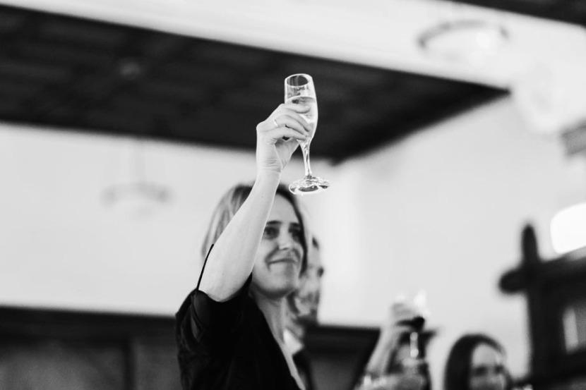 woman-raising-glass-during-wedding-speech