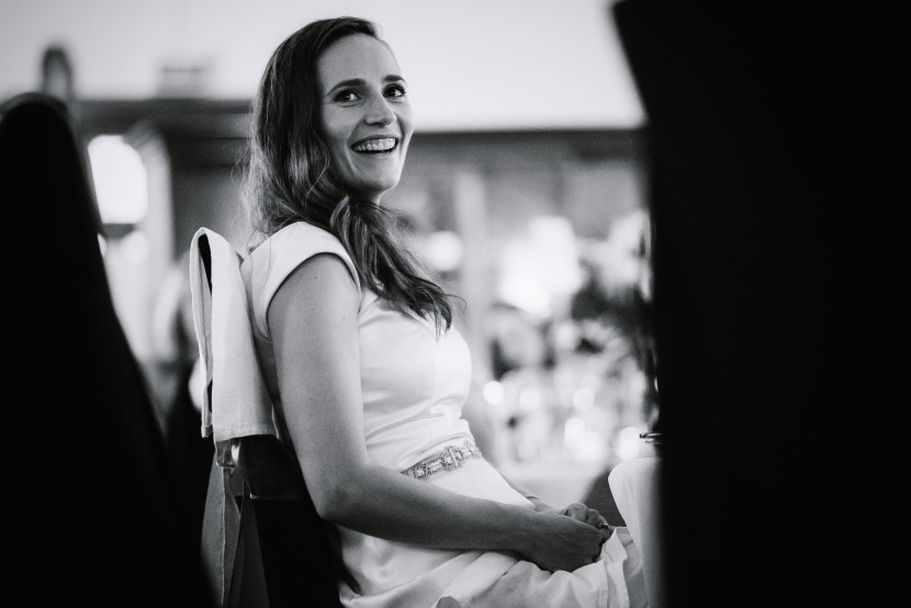 woman-laughing-during-wedding-speeches