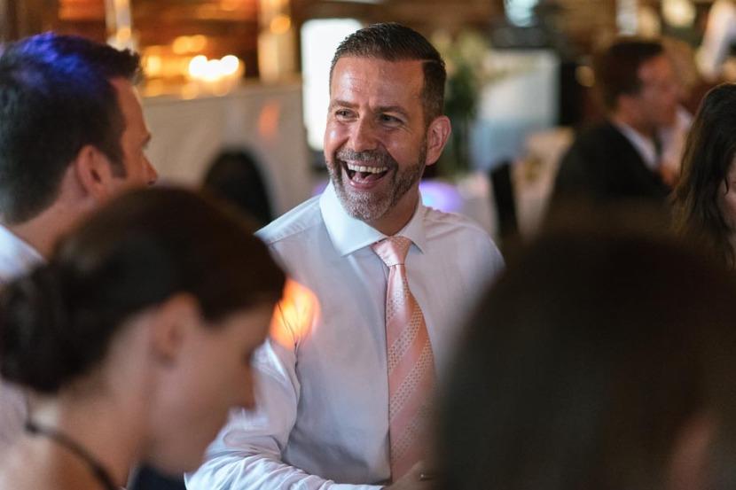 man-laughing-during-wedding-speeches