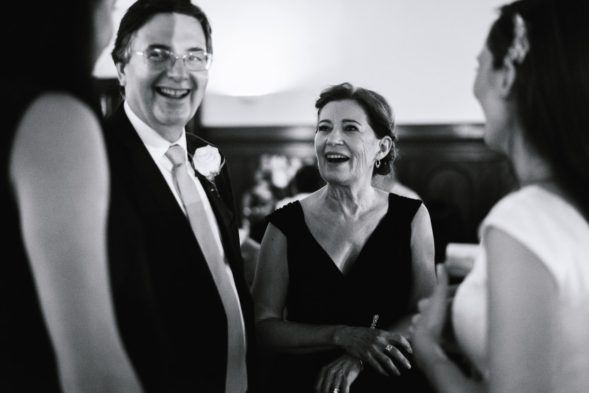 brides-mother-laughing-at-wedding