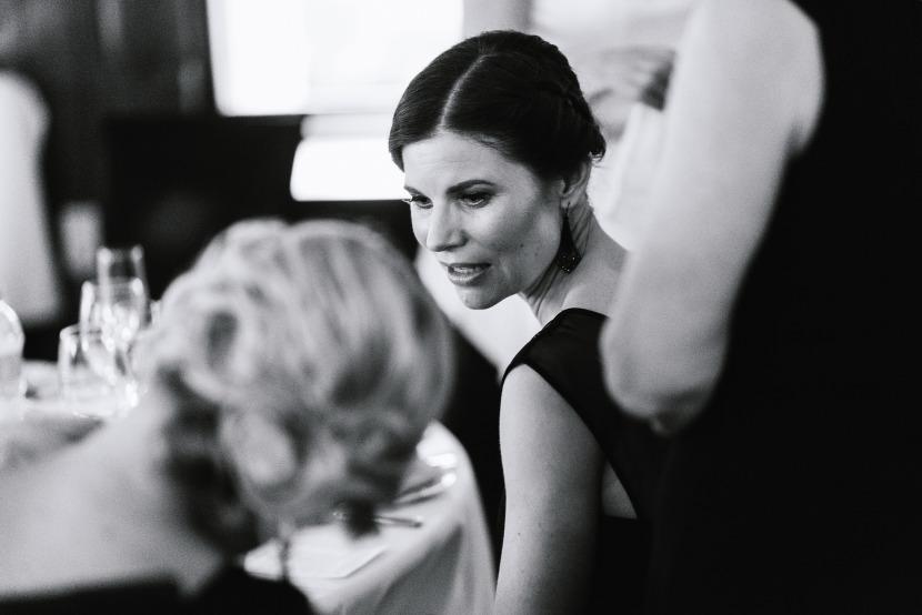 bridesmaids-talking-at-wedding-table